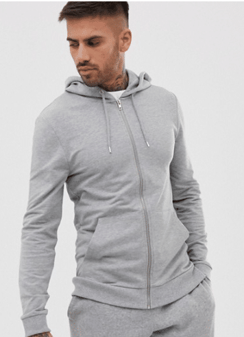 Male model wearing a grey muscle fit hoodie and grey sweatpants.