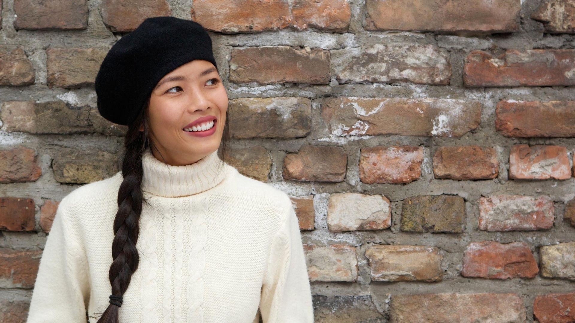 Woman wearing a black beret.
