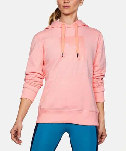 Woman in coral fleece hoodie with drawstrings.