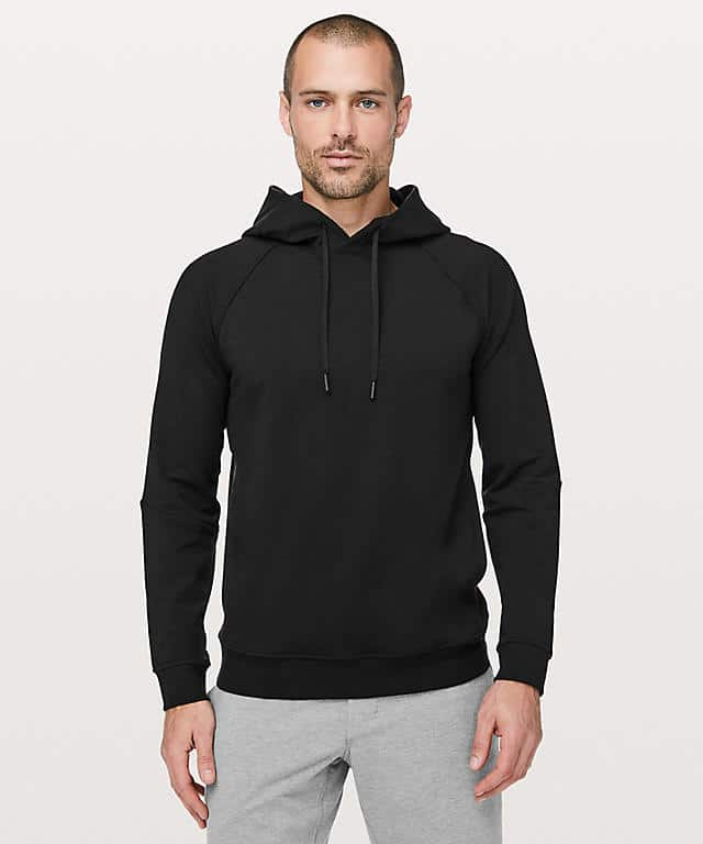 Man in a black hoodie with drawstrings.
