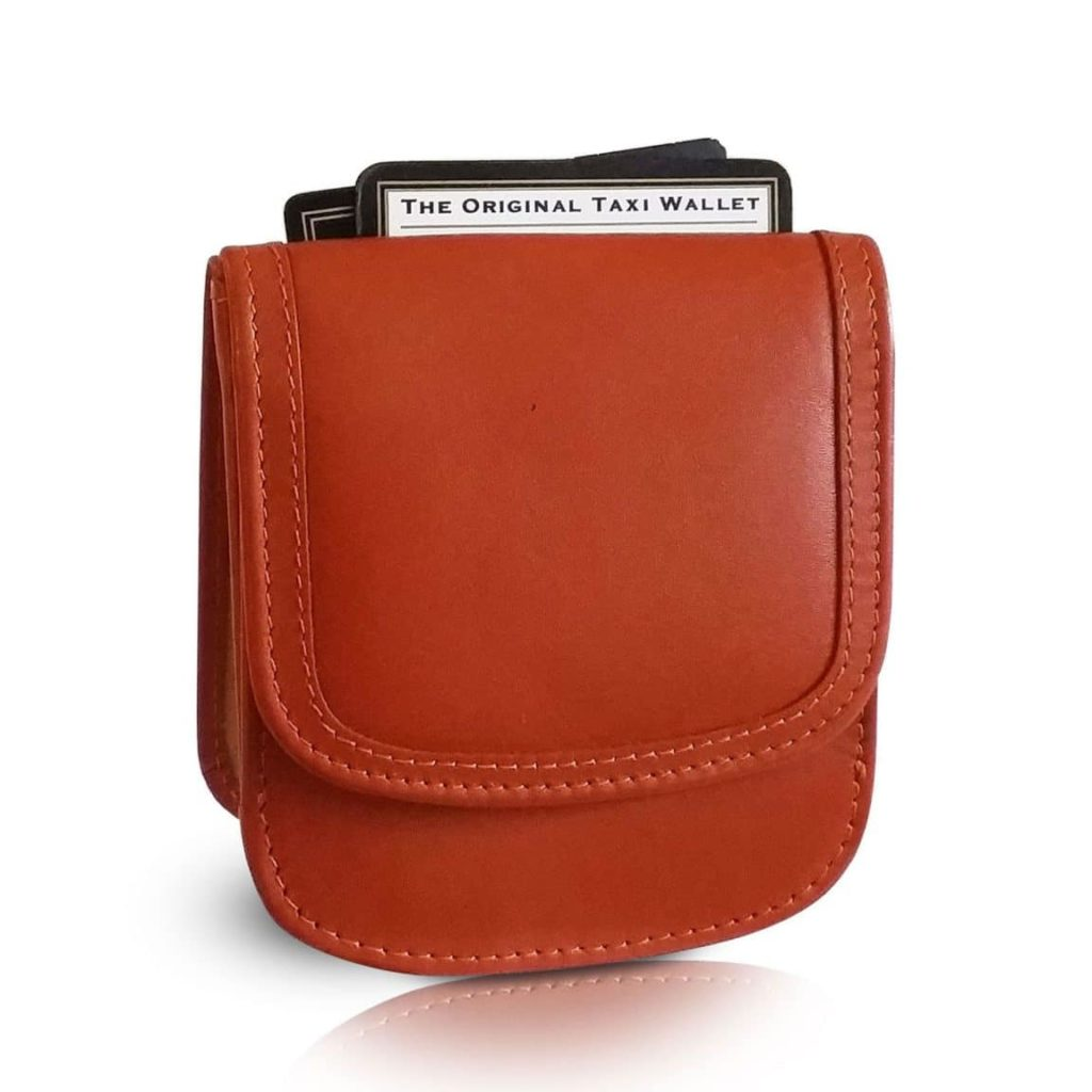 Brown leather taxi wallet. Two cards sticking out the back top of wallet.