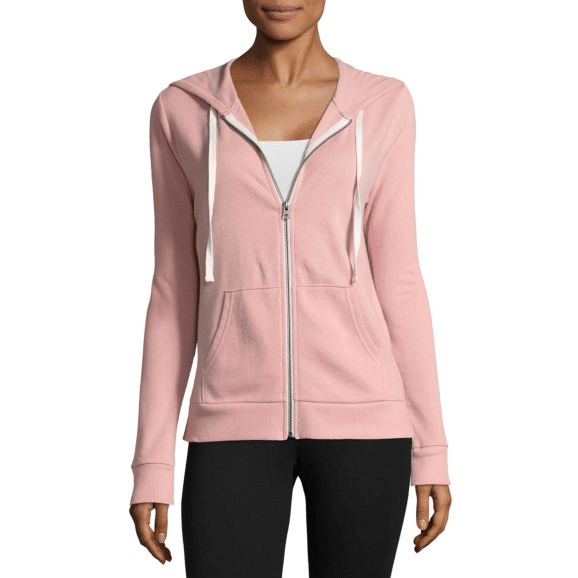 Woman in pink hoodie with front pockets and drawstrings.
