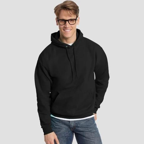 Male model wearing a black pullover hoodie.