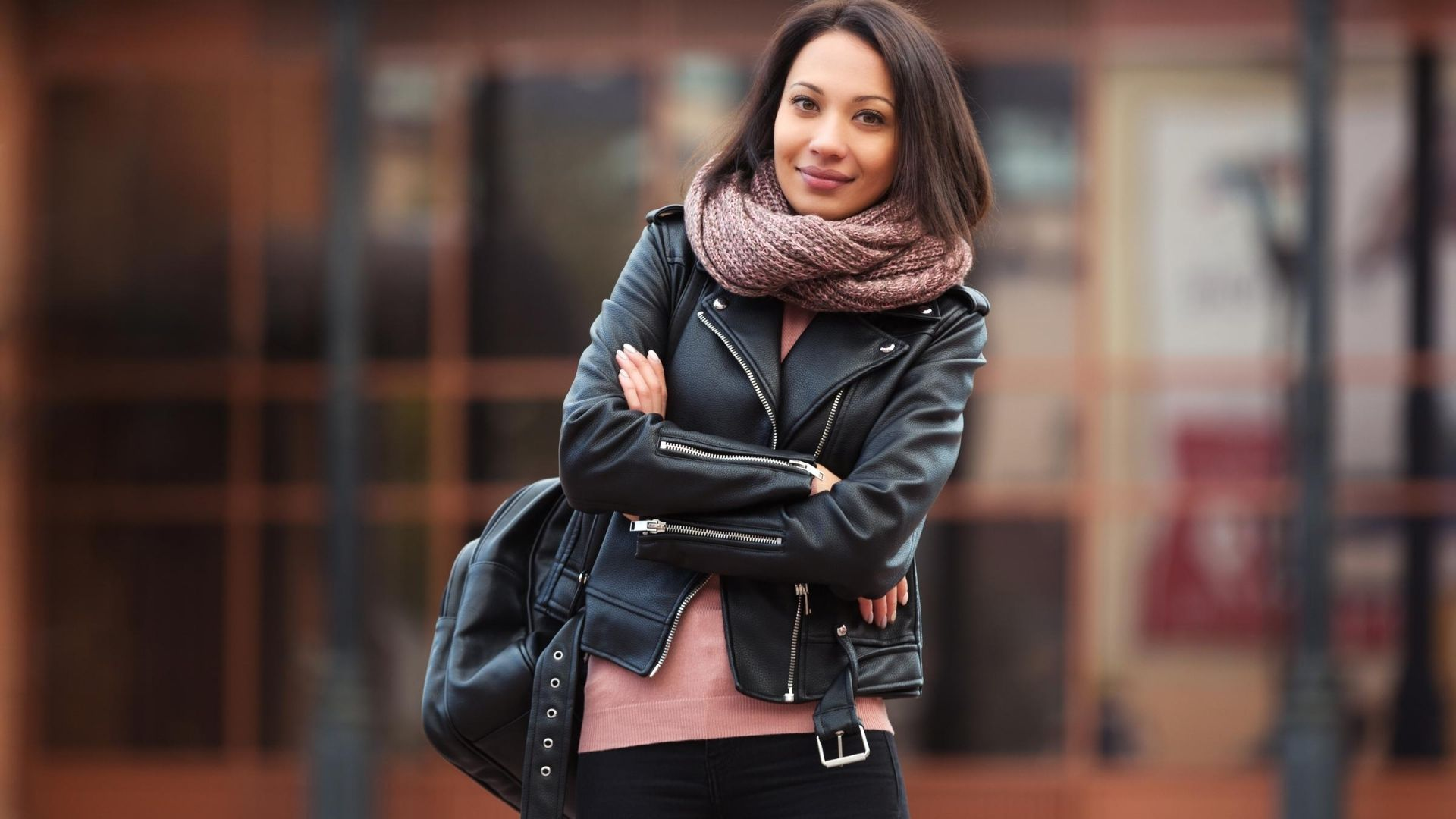 Woman wearing a black leather jacket.