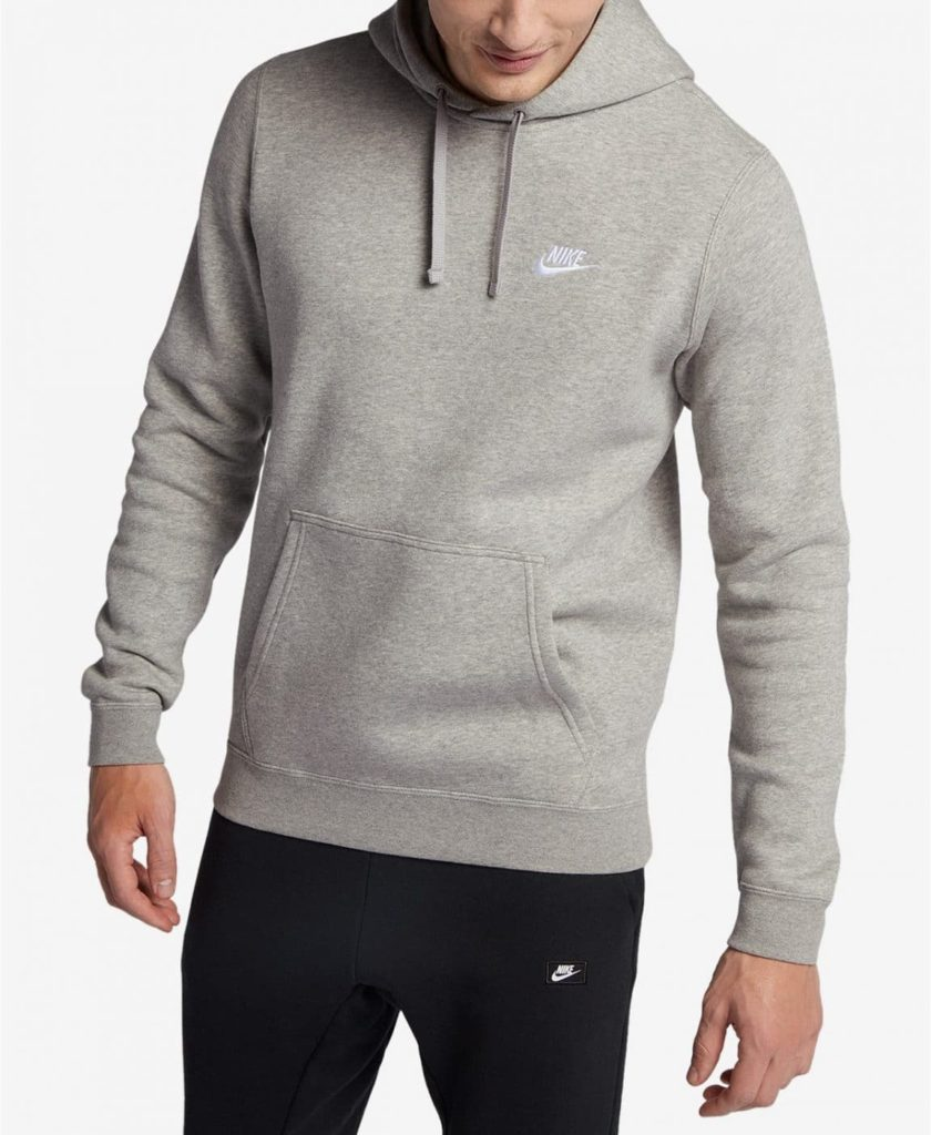 Man wearing a  Nike pull over hoodie with front pockets.