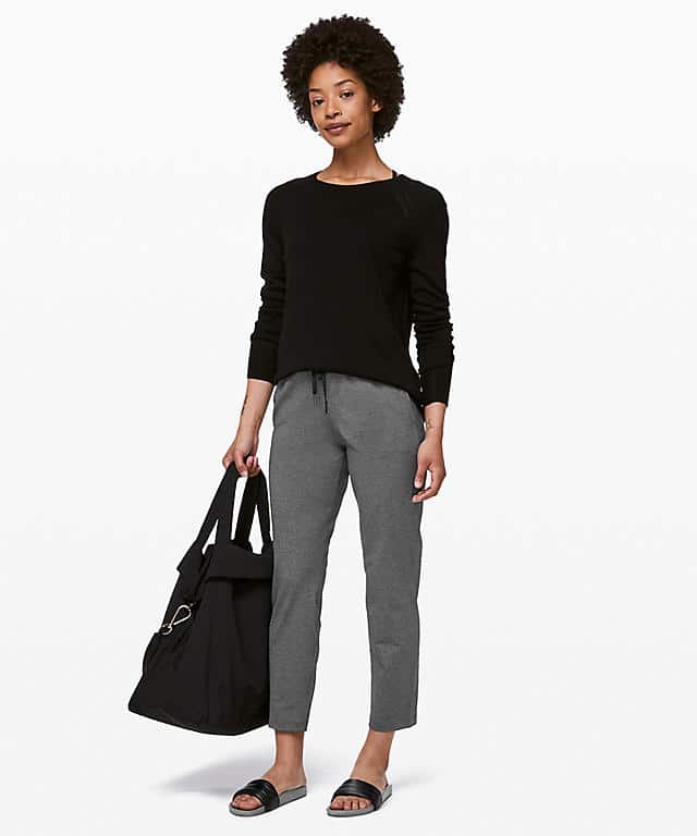 Woman wearing brown sweatpants with blue ankle cuffs.