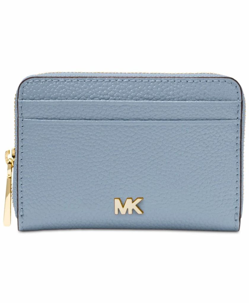 Leather zip around coin ad card wallet for women designed by Michael Kors.