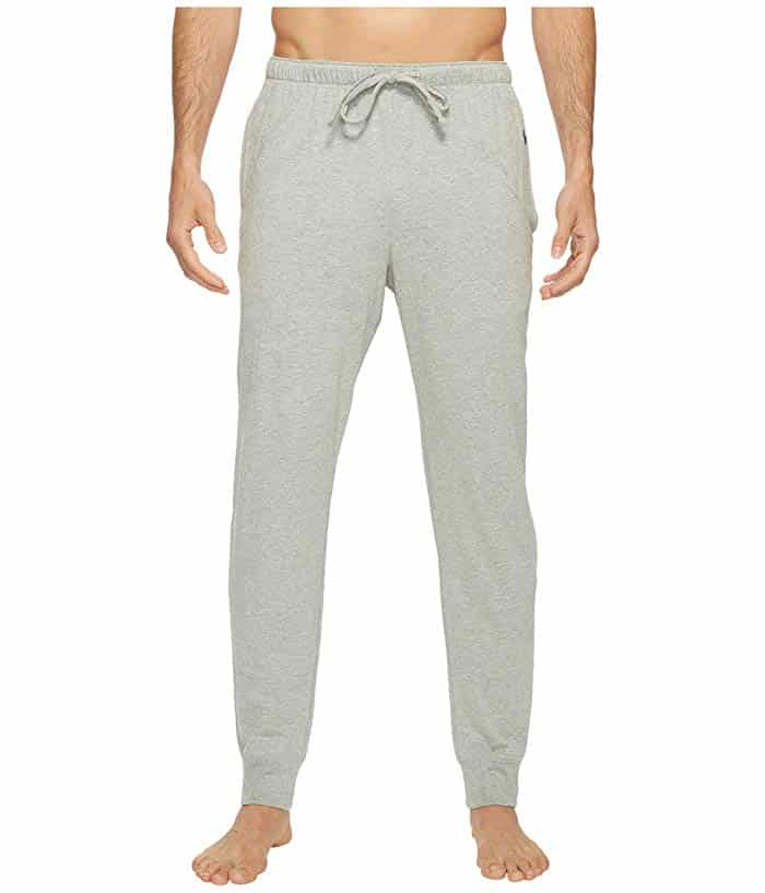 Grey relaxed fit sweatpants on a male model.