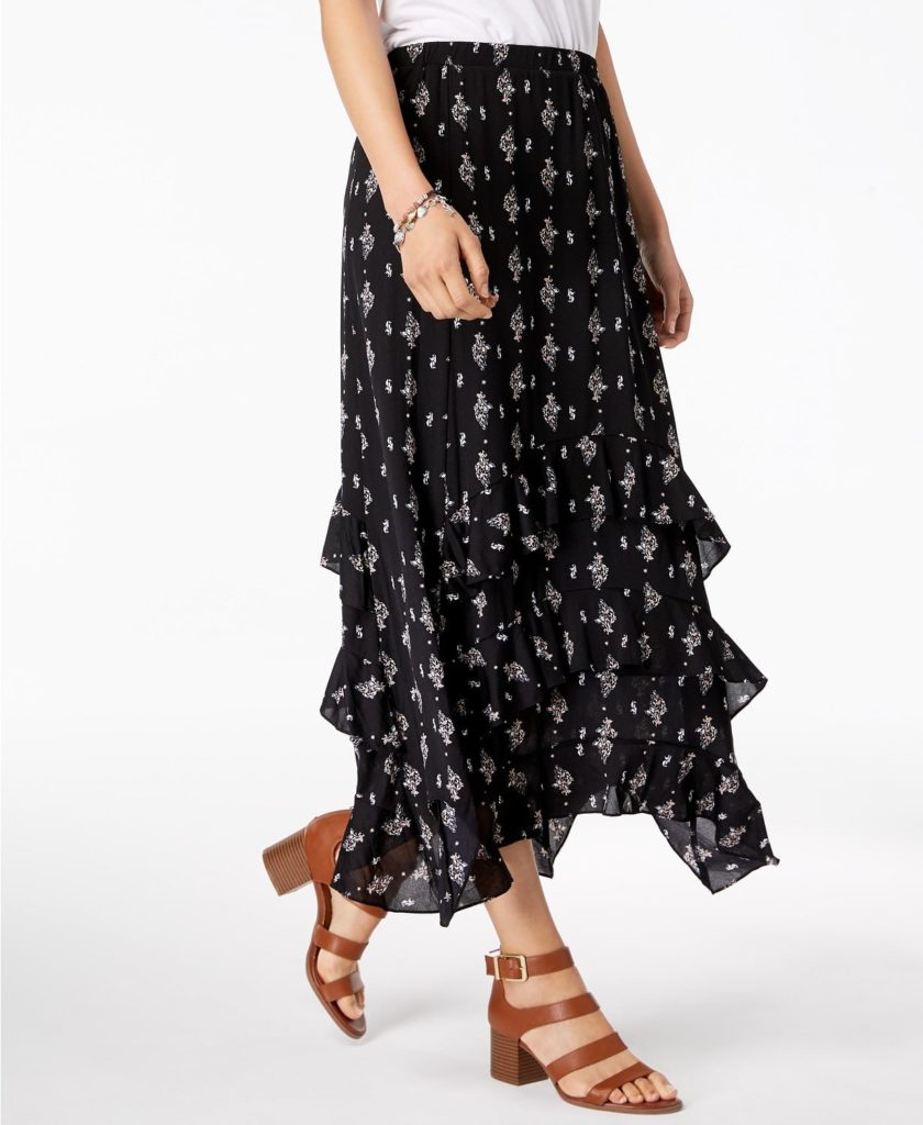 A black tiered skirt with floral design.