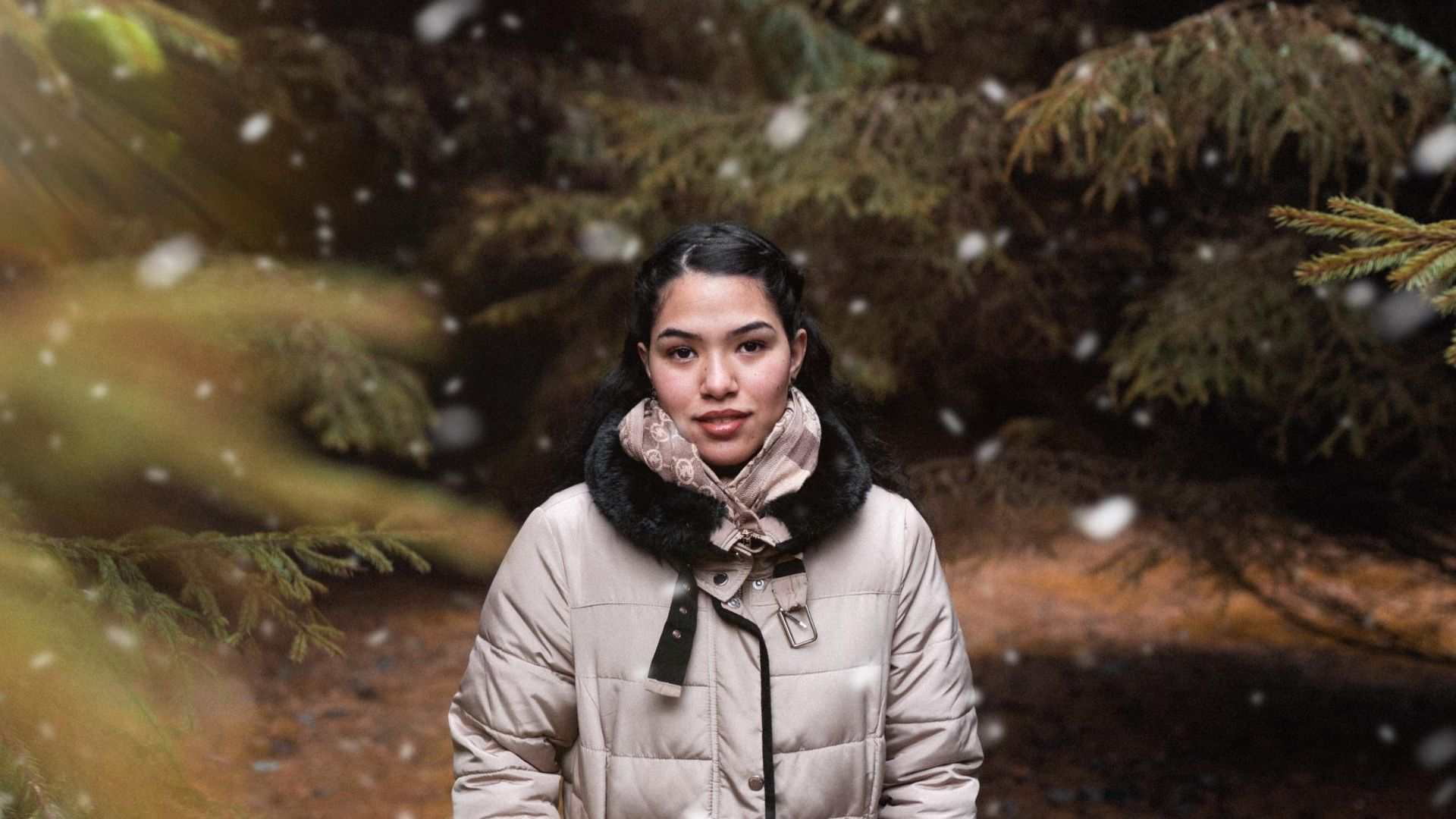 Woman wearing a puffer jacket in the snow.