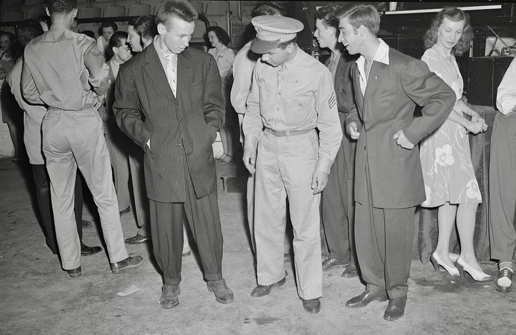 A soldier and two men wearing zoot suits with pegged pants in Washington D.C. in 1942